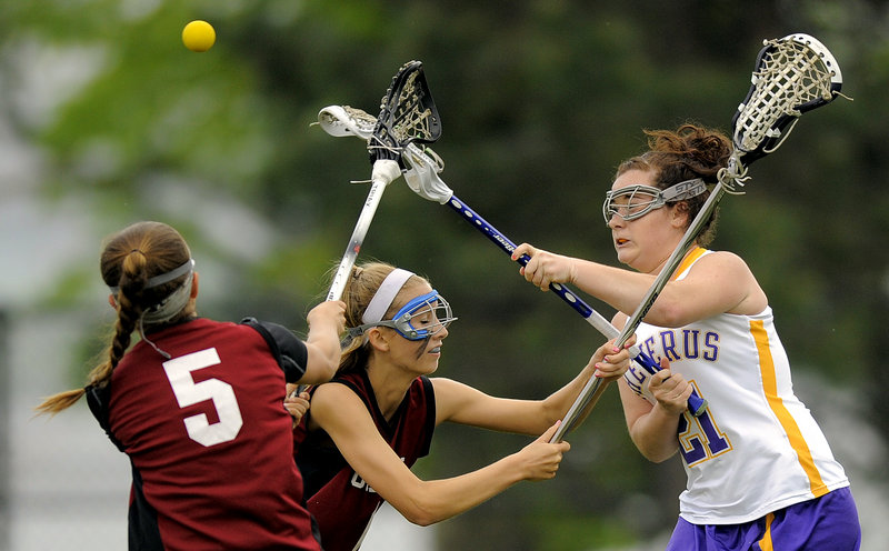 MaryKate Walsh of Cheverus, right, gets a shot off over two Gorham defenders, including Jackson Marshall, 5. Cheverus bounced back from a loss to Thornton Academy.