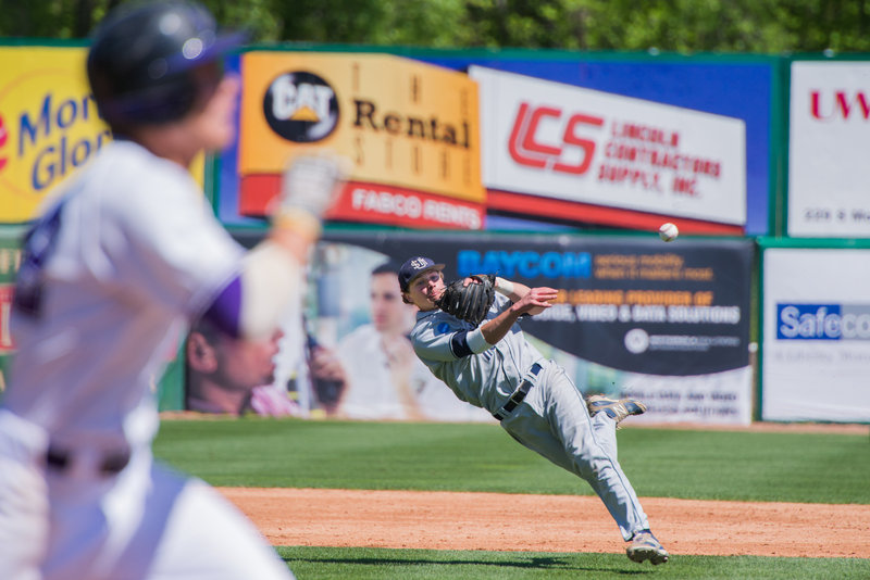 Southern Maine shortstop Sam Dexter gets his body into the throw and gets the Millsaps runner at first base for the first out of the fifth inning.