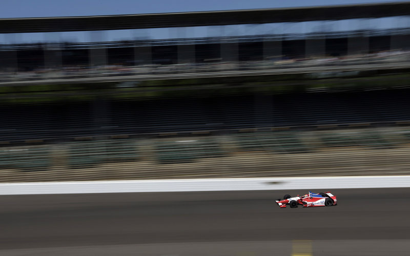 Justin Wilson of England heads into the first turn during the final practice session Friday for the Indianapolis 500 auto race at the Indianapolis Motor Speedway on Sunday, where his competitors will include the hometown favorite, Ed Carpenter.