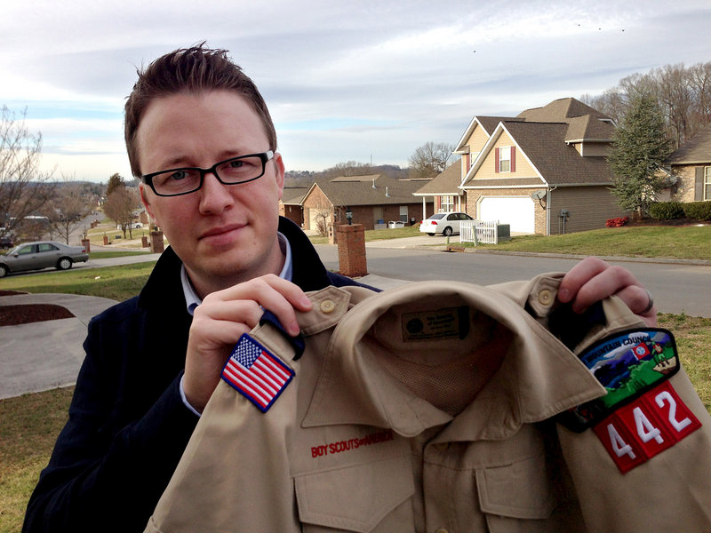 Wes Comer holds the Boy Scout uniform of his son, Isaiah, in Knoxville, Tenn. Comer, whose family attends an Apostolic Pentecostal church which considers homosexuality sinful, had been wrestling with whether to pull his eldest son out of the Scouts if the no-gays policy was abandoned.