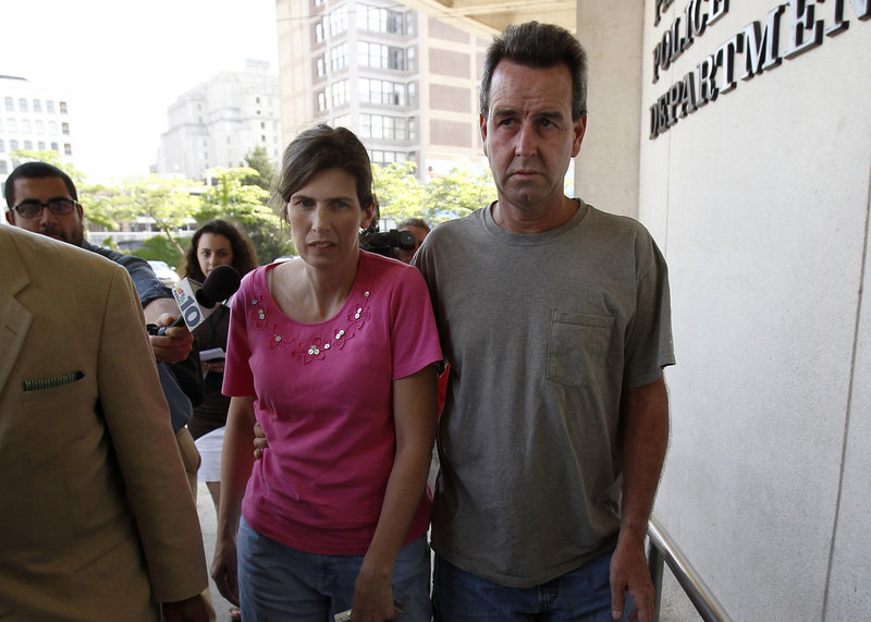 Catherine, left, and Herbert Schaible arrive at police headquarters in Philadelphia on Wednesday. The couple, who believe in faith healing over medicine, were charged with murder after a second young child died.