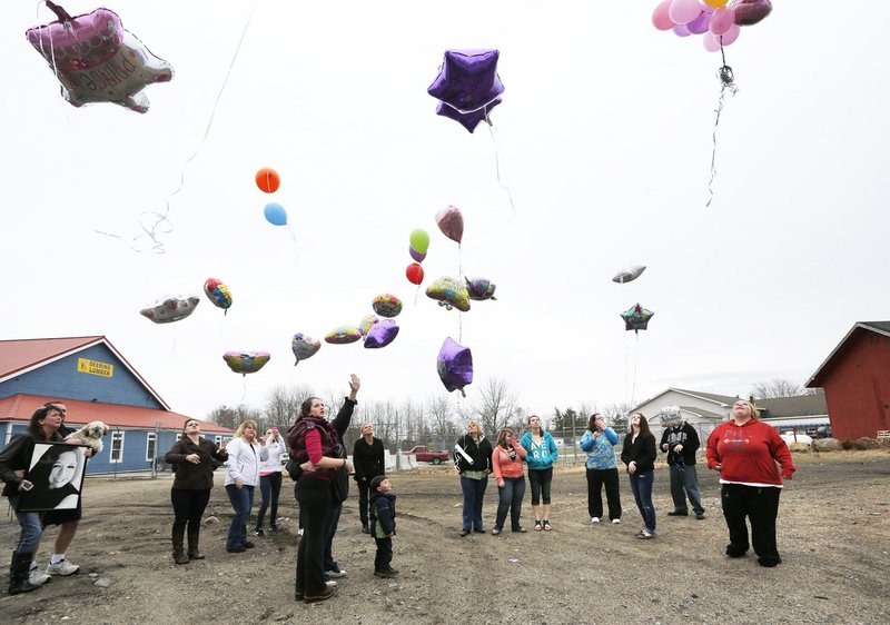 Family members and friends of Haley Plaisted release balloons on her 17th birthday, three days after her suicide last month, near a friend's house in Springvale. Loved ones are still struggling to find answers for why she chose to end her life.