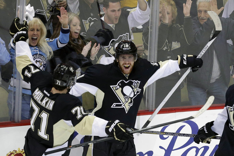 James Neal awaits a hug from Evgeni Malkin after scoring his third goal in Friday night's 6-2 rout of the Ottawa Senators, sending the Pittsburgh Penguins into the Stanley Cup semifinals against Boston or the New York Rangers.