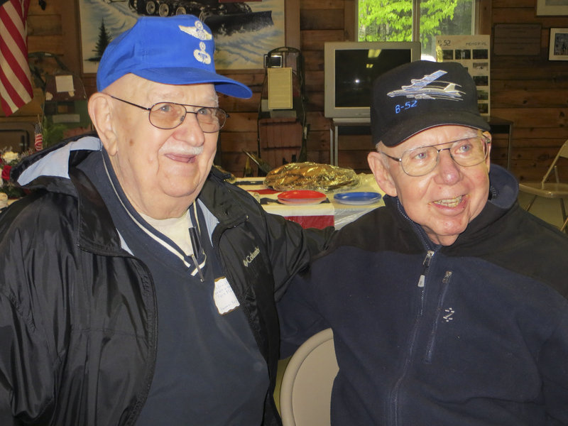 Eugene Slabinski, left, 83, of Hanover Township, Pa., poses with Gerald Alder, 81, of Davis, Calif., in Greenville at a 50th anniversary remembrance of the B-52 crash Saturday.