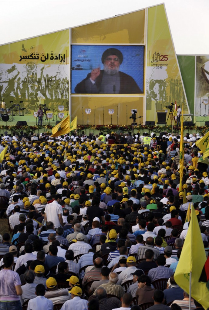 Sheikh Hassan Nasrallah talks Saturday in Mashghara, Lebanon. He said Hezbollah members are fighting in Syria against Islamic radicals who pose a danger to Lebanon.