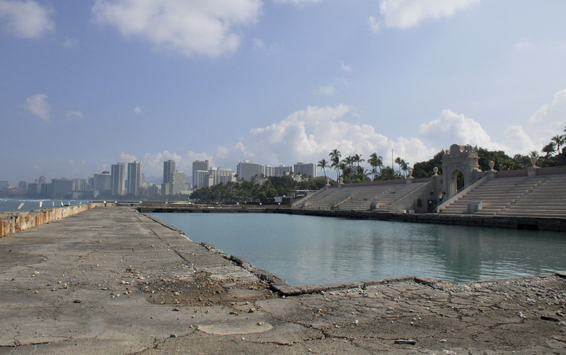 The Waikiki Natatorium in Honolulu, which includes a saltwater pool, was built in 1927 as a memorial to the 10,000 soldiers from Hawaii who served in World War I. The decaying structure has been closed to the public since 1979 amid debate over whether it should be demolished or restored to its former glory.