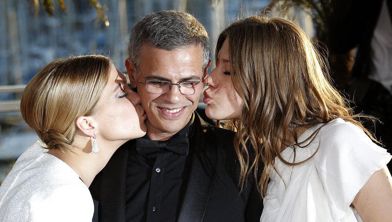 Actresses Lea Seydoux, left, and Adele Exarchopoulos flank director Abdellatif Kechiche in Cannes.
