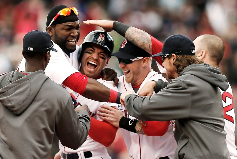 Jacoby Ellsbury is mobbed by teammates after his game-winning two-run double with two outs and the bases loaded in the ninth inning. Boston scored four runs in the ninth to beat Cleveland 6-5.