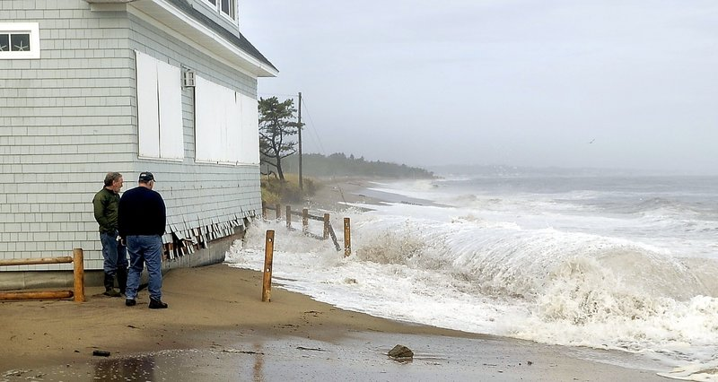 Waves crash at the end of Fairhaven Avenue in Camp Ellis last fall. Over the past four decades, the community has lost homes, roads and much of its beach to the ocean.