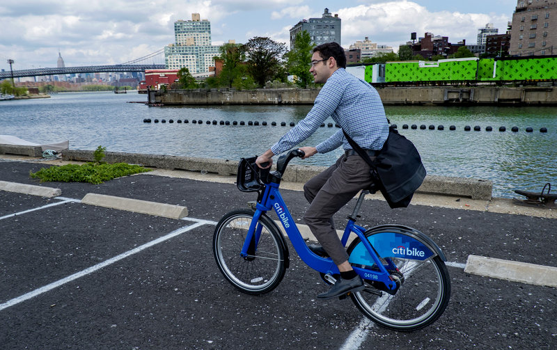 Alex Engel, with New York City Department of Transportation, rides a bike-sharing bicycle in New York.