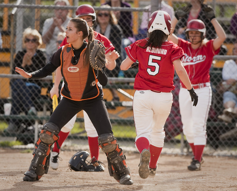 Biddeford catcher Katie Plante can only wait for a throw as Scarborough's Mary Redmond scores during a six-run fourth inning Tuesday. Redmond had walked earlier in the inning.