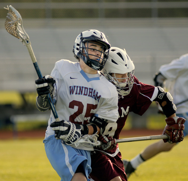 Bryce Rolfe of Windham braces for the impact he receives on a hit by Frank Pappalardo of Gorham during their game.