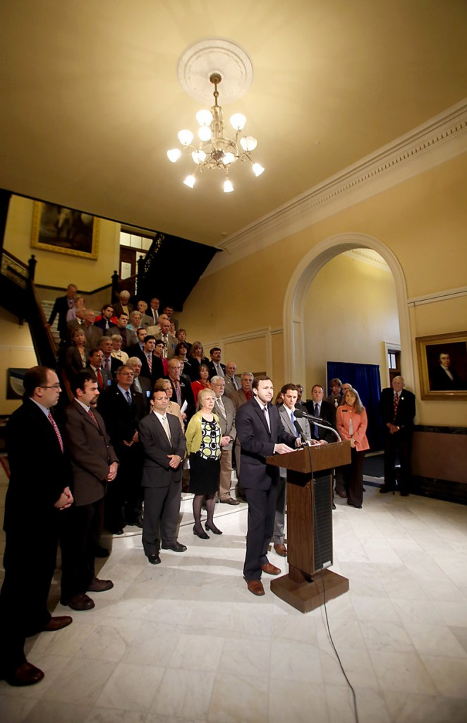 At a news conference Wednesday, May 29, 2013, House Speaker Mark Eves, D-North Berwick, left, and Senate President Justin Alfond, D-Portland, address the media at the Maine State House on the state's budget and possibly delaying a massive tax.
