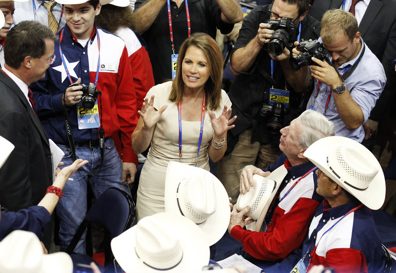 U.S. Rep. Michele Bachmann talks with members of the Texas delegation during the second session of the 2012 Republican National Convention in Tampa, Fla.