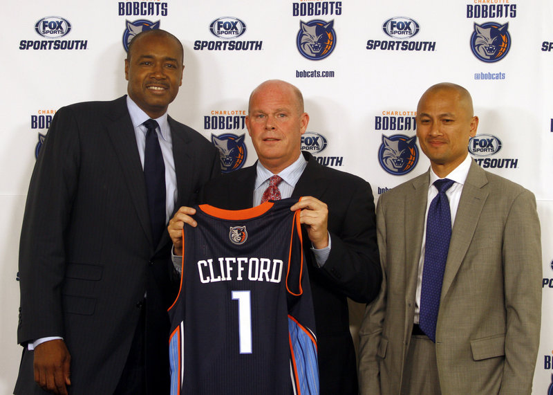 Steve Cliffford, who played at UMaine-Farmington and began his coaching career at Woodland High, is now the head coach of the Charlotte Bobcats, joining with Rod Higgins, left, the head of basketball operations, and General Manager Rich Cho.