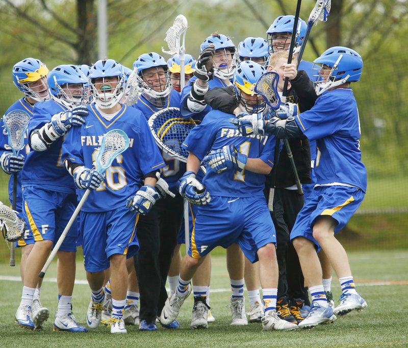 Will Nash, the goaltender, is the center of attention for the Falmouth boys' lacrosse team Wednesday after the Yachtsmen came away with an 11-10 victory against North Yarmouth Academy in a regular-season finale.