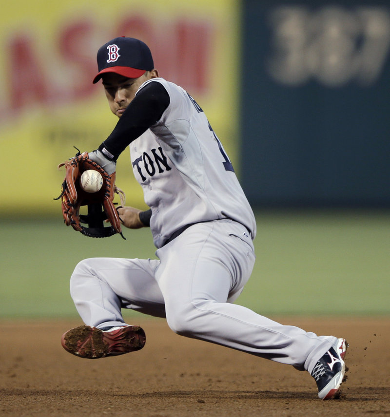 Jose Iglesias of the Boston Red Sox can't handle a sharp infield single by Kyle Kendrick of the Philadelphia Phillies during the fourth inning of the Phillies' 4-3 victory Wednesday night.