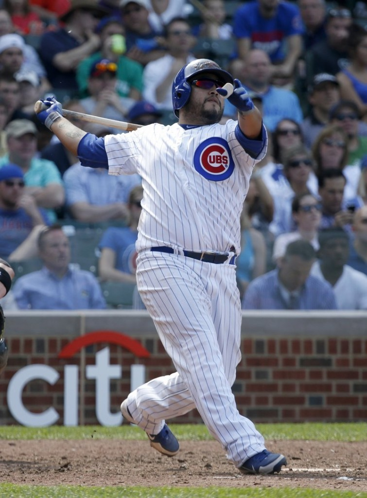 Dioner Navarro of the Cubs hits his third homer of the game Wednesday in leading his team over the White Sox, 9-3.