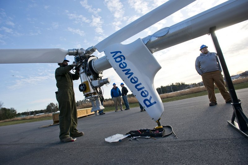 In this April 2013 file photo, a team from the University of Maine at Orono test a turbine outside of their laboratory at UMO. Hundreds of people are expected on the banks of the Penobscot River in Brewer on Friday morning to see and celebrate history in the making, as North America's first floating offshore wind turbine is lowered into the water.