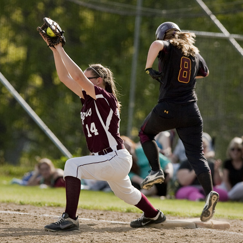 Mykaela Twitchell, the Greely first baseman, stretches to haul in a throw Thursday in time to retire Hannah Saturley of Cape Elizabeth during the Capers' 5-0 victory in a game between two of the top teams in Class B.