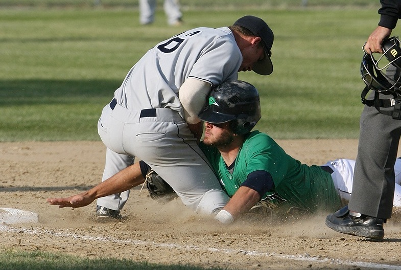 Nick Grady of the University of Southern Maine tags out Tad Gold of Endicott College as he slides into third base Saturday during the NCAA Division III New England baseball tournament in Harwich, Mass. USM and Endicott will play for the regional championship Sunday.