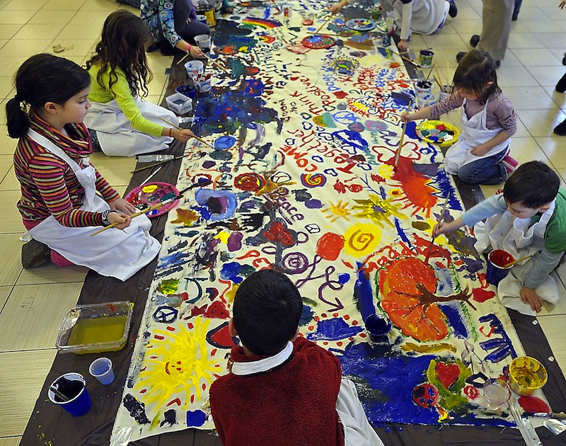In this January 2013 file photo, students at Ocean Avenue Elementary School paint a Wall of Dreams mural to honor Martin Luther King, Jr. Facing overcrowding for a second year at Ocean Avenue Elementary School, the Portland School Board voted Tuesday, June 25, 2013 to carve out two neighborhoods on the edges of the school's existing community and have new kindergartners there go to either East End or Hall elementary schools.