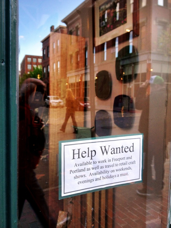 A help-wanted sign is posted on the door of a shop in Portland's Old Port last month. Maine's jobless rate has hit a 4½-year low.
