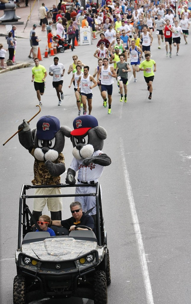 Slugger and his dad escort runners from the start of the Portland Sea Dogs Father's Day 5K.