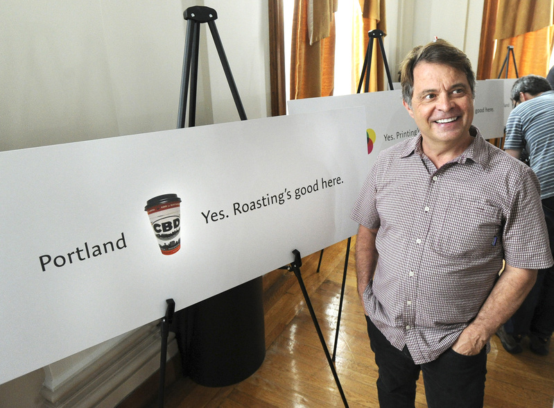 Coffee By Design co-owner Alan Spear said he's happy with the new city slogan. Slogan