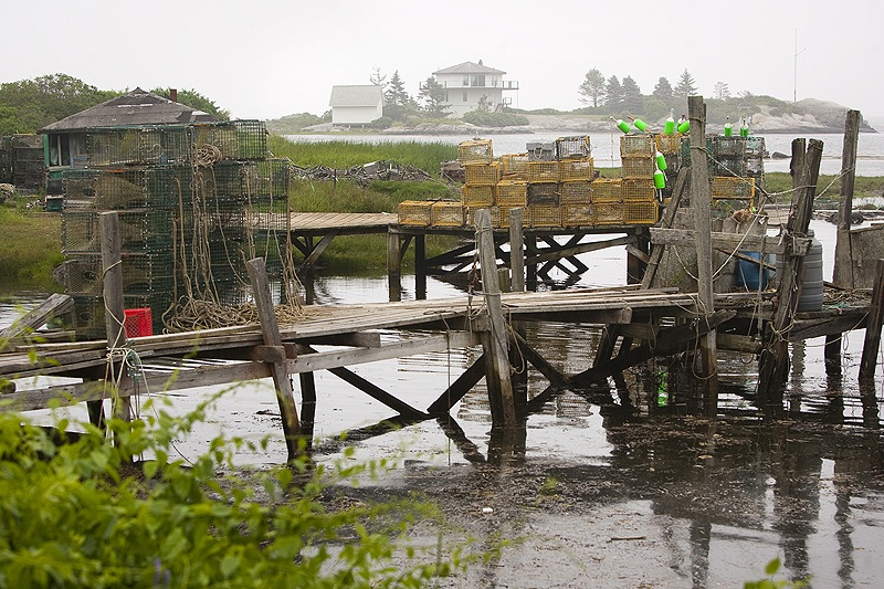 Lobster traps are stored last week on the wharf of Harbor d'Grace in the town of Long Island, a 45-minute ferry ride from Portland.