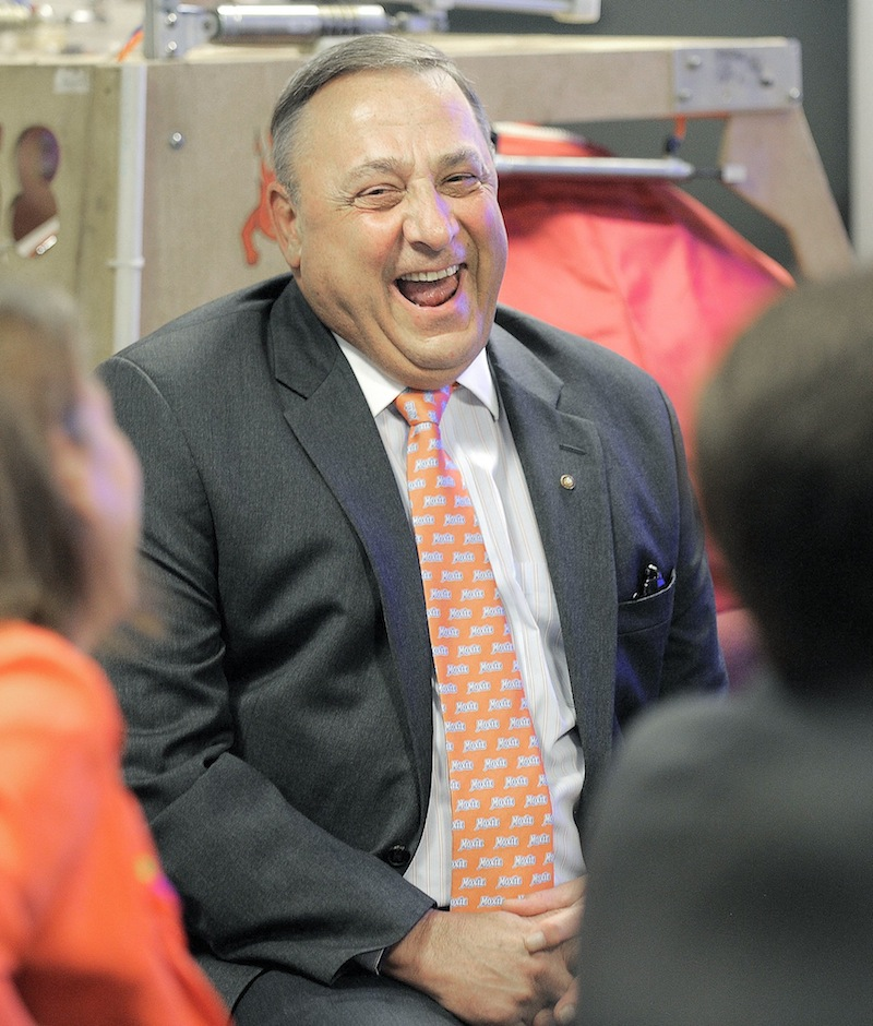 Gov. Paul LePage laughs at a joke made by Dean Kamen, inventor of the Segway PT, during an event at Fairchild Semiconductor in South Portland on Thursday.