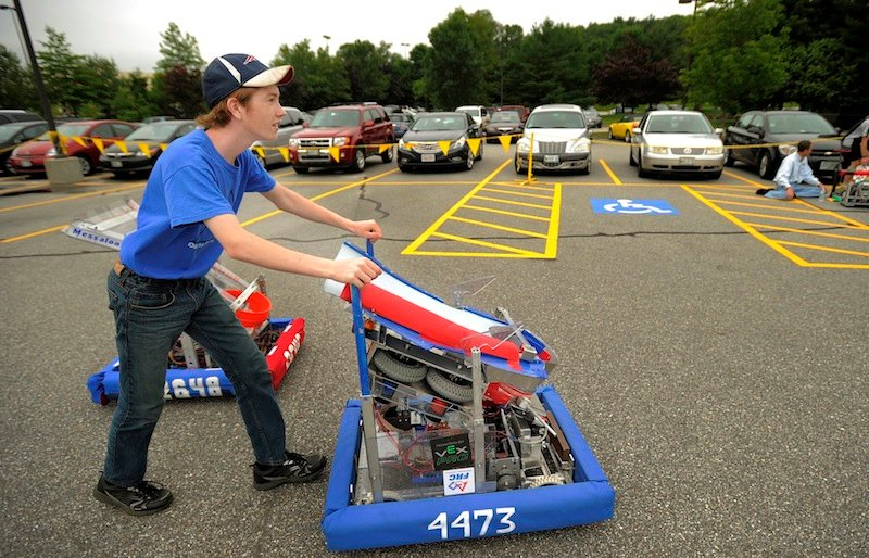 Colt Seigars, a homeschooler from Augusta, pushes his robot,