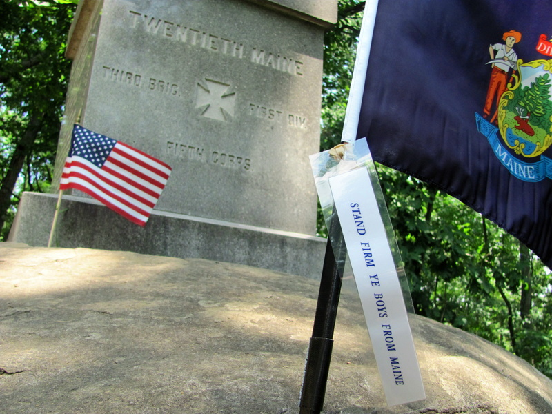 A Maine flag is planted near the base of the monument to the 20th Maine Regiment, located on the slopes of Little Round Top where the Battle of Gettysburg was fought.