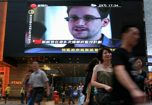 A TV screen shows a news report of Edward Snowden, a former CIA employee who leaked top-secret documents about sweeping U.S. surveillance programs, at a shopping mall in Hong Kong on Sunday.