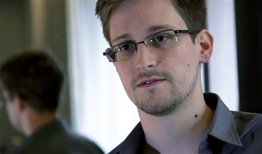 This photo provided by The Guardian Newspaper in London shows Edward Snowden, who worked as a contract employee at the National Security Agency, on Sunday, June 9, 2013, in Hong Kong. The Guardian identified Snowden as a source for its reports on intelligence programs after he asked the newspaper to do so on Sunday. (AP Photo/The Guardian)