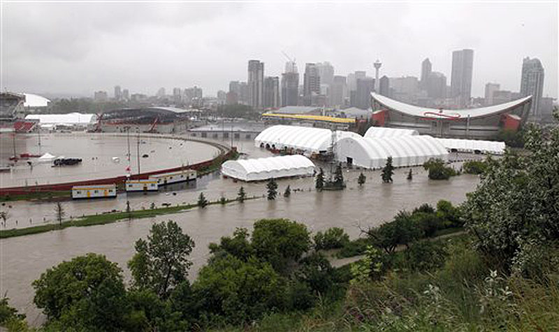 The Calgary Stampede grounds and Saddledome are flooded due to heavy rains in Calgary, Alberta, on Friday. Flooding forced the western Canadian city to order the evacuation of the entire downtown area on Friday, as the waters reached the 10th row of the city's hockey arena. Canada;Canadian;Alberta;AB;flooding;flood;water;evacuate;rise;we