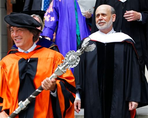 Dr. Jeff Nunokawa, a Princeton University professor of English, holds the school's ceremonial mace as Federal Reserve Chairman Ben Bernanke leads the processional out of the university's chapel after giving the baccalaureate address Sunday.