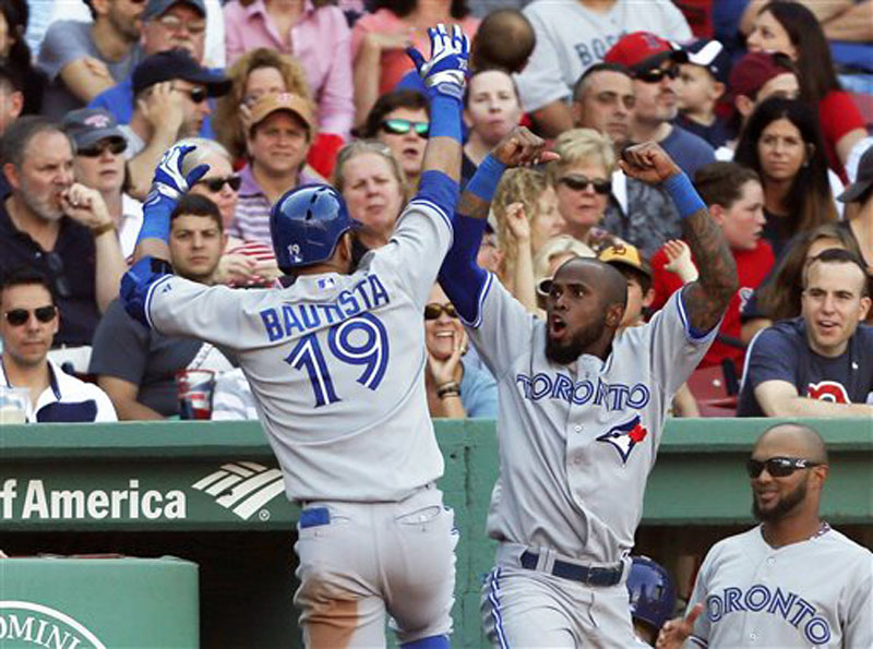 Toronto's Jose Bautista, left, and Jose Reyes exult after Bautista's two-run homer Saturday at Fenway Park. The Blue Jays beat the Red Sox, 6-2.
