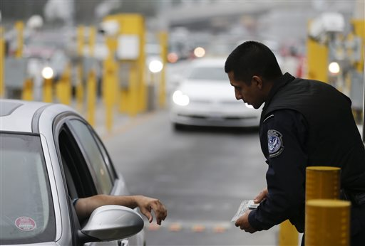 A Customs and Border Protection officer speaks to a driver at the San Ysidro port of entry on Thursday in San Diego.