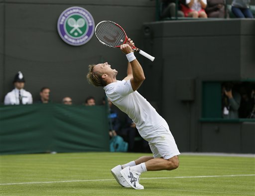 Steve Darcis of Belgium reacts as he defeats Rafael Nadal of Spain in their men's first round singles at Wimbledon Monday.