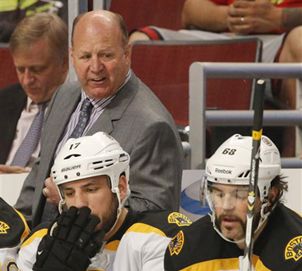 Boston Bruins coach Claude Julien reacts after a goal by the Chicago Blackhawks in the first period during Game 2 of the Stanley Cup Finals on Saturday in Chicago.