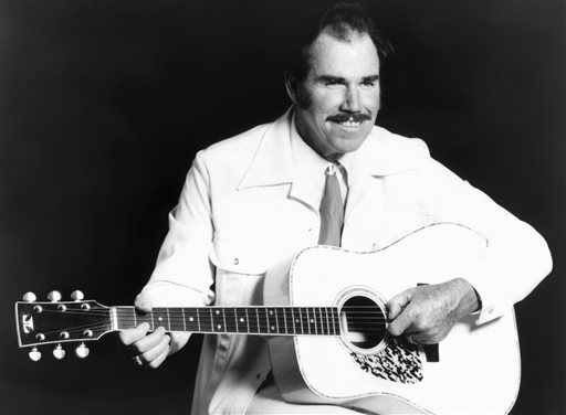 This undated photo shows country singer Slim Whitman. His career began in the late 1940s, and his tenor falsetto and ebony mustache and sideburns became global trademarks.