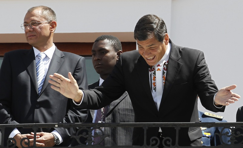 "Ecuador's President Rafael Correa, right, greets passersby from the balcony of the presidential palace during the weekly, The Change of the Guard, in Quito, Ecuador, Monday, June 24, 2013. Correa declared Monday that national sovereignty and universal principles of human rights would govern his decision on granting asylum to Edward Snowden, powerful hints that the former National Security Agency contractor is welcome in Ecuador despite potential repercussions from Washington. Correa said on Twitter that ""we will take the decision that we feel most suitable, with absolute sovereignty."" Vice president Jorge Glass is pictured left. (AP Photo/Dolores Ochoa)"