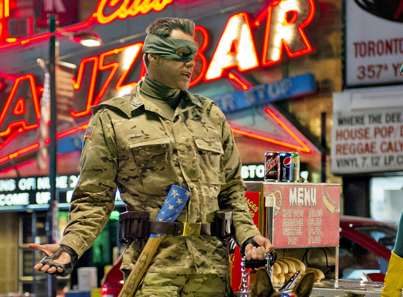 """Jim Carrey portrays Colonel Stars and Stripes in a scene from """"Kick-Ass 2."""""""