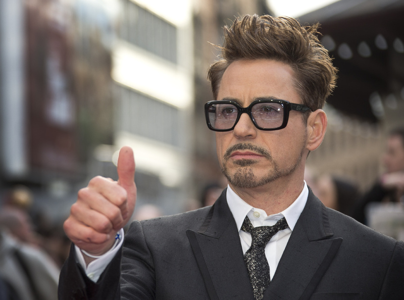 "Robert Downey Jr. will reprise his role as Iron Man/Tony Stark for both ""The Avengers 2"" and ""The Avengers 3."" Black Frame Glasses Black Framed Glasses Glasses Hand Gesture Head and Shoulders One Person Portrait Purple Lenses Thumbs Up"
