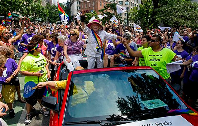 Grand Marshal Edith Windsor, the 84-year-old woman at the center of the U.S. Supreme Court decision granting gay couples federal marriage benefits, is surrounded by well wishers during the gay pride march in New York Sunday.