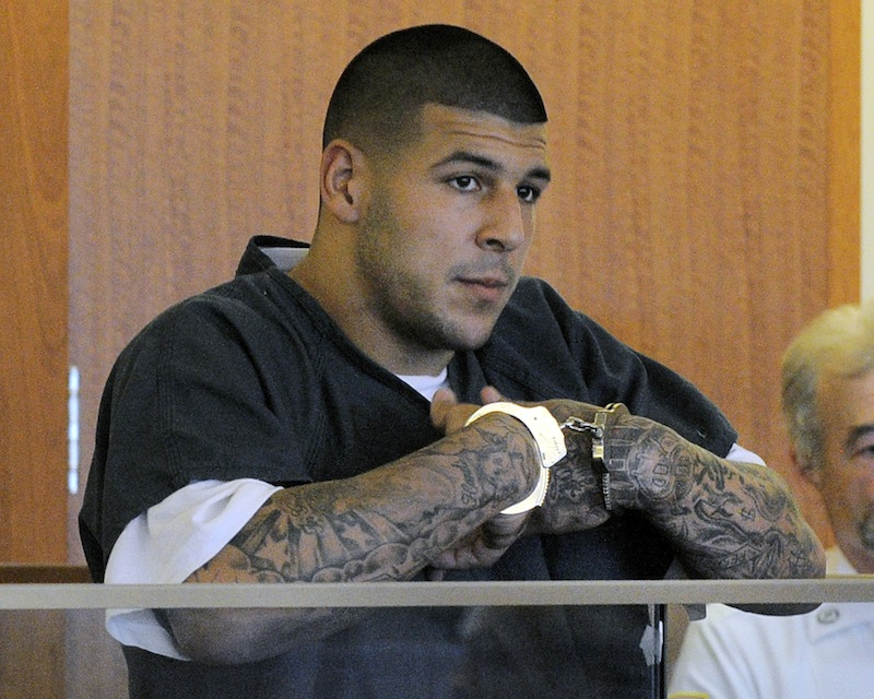 Former New England Patriots football tight end Aaron Hernandez stands during a bail hearing in Fall River Superior Court Thursday, June 27, 2013 in Fall River, Mass. Hernandez, charged with murdering Odin Lloyd, a 27-year-old semi-pro football player, was denied bail. (AP Photo/Boston Herald, Ted Fitzgerald, Pool)