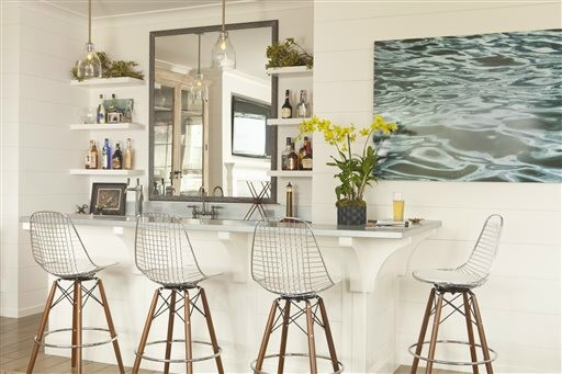 This bar with its beach-inspired design demonstrates how the sun-drenched colors and windswept beachfront textures of summer provide ample inspiration for indoor decorating. With a light touch and careful choices, summer can provide ideas for an interior you'll love all year long.