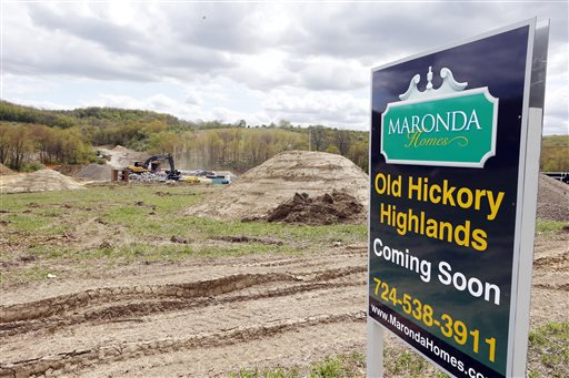 Construction is under way on the infrastructure of a multi-acre housing development in Zelienople, Pa., recently,