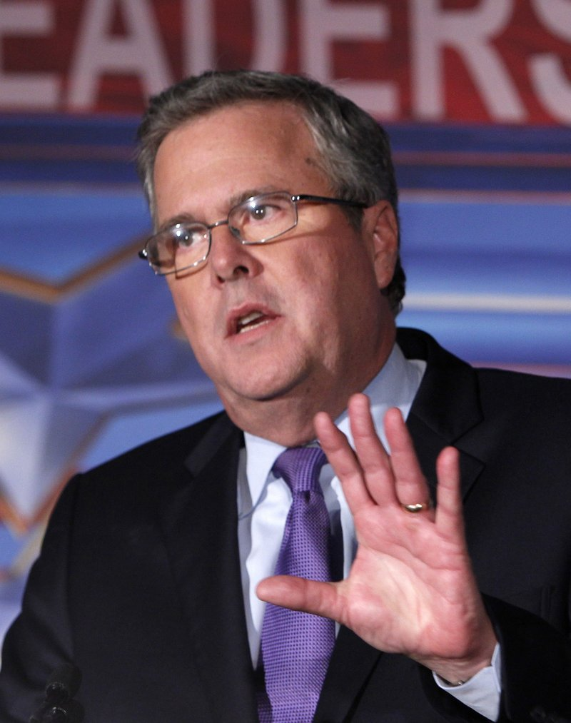 In this Jan. 26, 2012 file photo, former Florida Gov. Jeb Bush speaks in Miami. Bush will headline a re-election campaign event for Maine Gov. Paul LePage next month. (AP Photo/Wilfredo Lee, File)